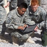 Photo of U.S Army soldiers testing a Harris PRC-117G software-defined radio.