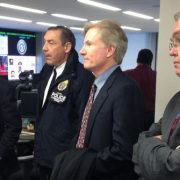 Photo of FirstNet board members and technical staff listen to a Sandy briefing