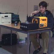 An amateur-radio operator testing equipment in a shelter after Superstorm Sandy.