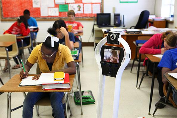 Photo of a high-school student attending class through his VGo robot