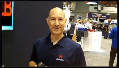 L3Harris: John Serio showcases company's new microphone for XL mobile radios with keypad, noise cancellation